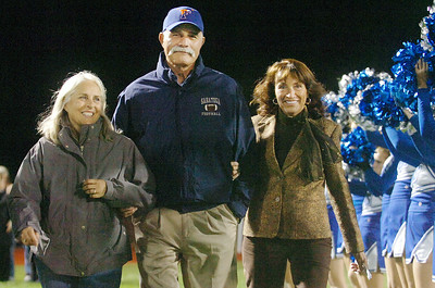 Blue Streak Athletic Hall of Fame inductee Blase Iuliano walks onto the field with his wife Barbara (left) and sister Deborah Iuliano in arm during half time at the Saratoga Homecoming football game against Troy. Photo Erica Miller 10/1/10 spt_Homecoming1_Sat