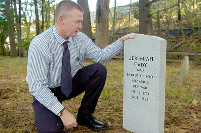 Mike Companion kneels next to the new gravestone he recently placed for Jeremiah Cady, who deceased in 1798, at the Cady Hill Cemetery which is located near the Industrial Park. Sunday Companion will be dedicating this gravestone during a ceremony. Photo Erica Miller 9/30/10 news_Gravestone1_Sat