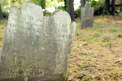 A gravestone sits of a thirteen year old boy at the Cady Hill Cemetery. Mike Companion laid a new gravestone placed for Jeremiah Cady, who deceased in 1798. Sunday Companion will be dedicating this gravestone during a ceremony. Photo Erica Miller 9/30/10 news_Gravestone3_Sat
