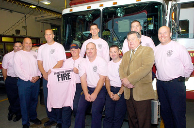 Saratoga Springs Firefighters wear their pink shirts with pride this month as they support Breast Cancer Awareness month with a drive and fundraiser. Shirts will be worn all month long and for sale at Impressions of Saratoga on Broadway. Photo Erica Miller 10/1/10 news_SSFDpink_Sat