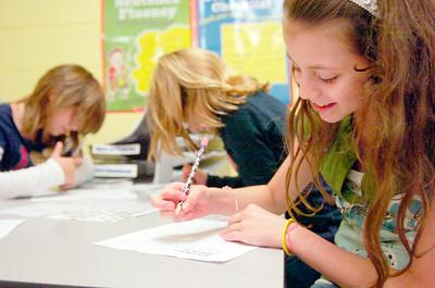 Fifth grader Brianna Vanderbogart works on her writing skills with fellow students in her Literacy Work Station at Ballard Elementary. Photo Erica Miller 10/1/10 wg_LiteracyWork2