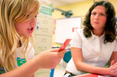 Fifth grader Sierra Laroe reads to Mrs. Roseanne McGough at the comprehension board game in her Literacy Work Station at Ballard Elementary. Photo Erica Miller 10/1/10 wg_LiteracyWork1