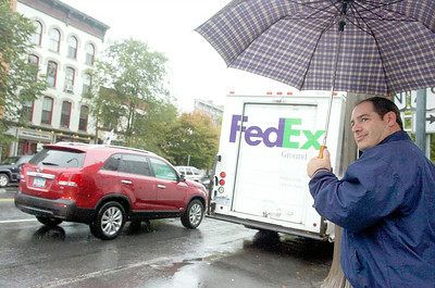 Scott Clark waits to cross Broadway with his umbrella, today forecast showed 100 percent precipitation throughout the day into tomorrow. Photo Erica Miller 9/30/10 news_RainyDay2_Fri