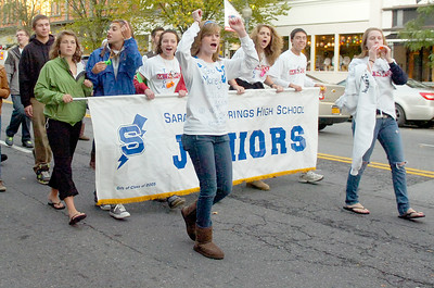 Saratoga Springs High School Juniors scream and shout as they walk down Broadway for their Homecoming Parade Friday evening. Photo Erica Miller 10/1/10 new_Parade3_Sat