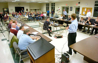 Kurt Shaner, Eastern Region Engineering Manager for Waste Connections, makes a point during a presentation Thursday evening to a joint meeting of the Town and Village of Corinth boards regarding possible development at the site of the former International Paper Co. plant which closed in 2002. Ed Burke 9/29/11