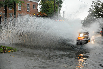 A truck speeds through the intersection of Circular St and Lake Ave, after the city got hit with a strong storm causing flash flooding in certain areas. Photo Erica Miller 9/29/11 news_FlashFlood_Fri