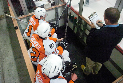 A hat trick of penalties lands three Adirondack Phantoms in the penalty box during Wednesday's game against the Wilkes-Barre/Scranton Penquins at Saratoga Springs Ice Rink. Ed Burke 9/28/11