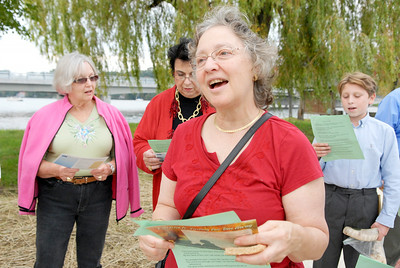 Louise Golub sings along with fellow members of the congregation Shaara Tfille to Hine Matov at Saratoga Lake in celebration of the new year on Friday. Photo Erica Miller 9/30/11 news_JewishYear4_Sat