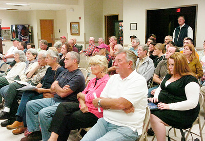 Corinth area residents listen to Thursday's presentation about possible development on the site of the former IP paper mill in Corinth. The presentation was made to the town and village boards during a meeting at the Corinth Volunteer Fire Department. Ed Burke 9/29/11