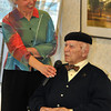 with Meghan story<br /> Gillian Jones/North Adams Transcript<br /> Foster H. Nystrom, an artist and resident of Sweetbrook in Williamstown, was given a lifetime achievement award by the facility in a ceremony on Friday. His daughter Cynthia McFarland holds the microphone for him to speak into.