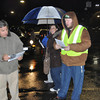with meghan story<br /> Gillian Jones/North Adams Transcript<br /> Matt Andrews gives Wal-mart shoppers a map of the store on Friday morning prior to the store opening at 5 a.m. for Black Friday.
