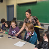 with Jen story<br /> Gillian Jones/North Adams Transcript<br /> Bernadette Lupo hands out an MCLA brochure to eighth graders during a workshop about a career in marketing and public relations Wednesday at MCLA.