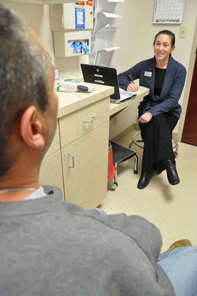 with Jen story<br /> Gillian Jones/North Adams Transcript<br /> Nurse Practicitioner Carrie Murphy meets with a patient at Williamstown Medical Associates in North Adams.