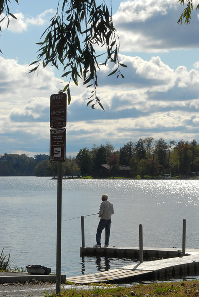 Gillian Jones/North Adams Transcript<br /> Don Guerin of Adams fishes off the dock at Cheshire Lake in Cheshire Monday afternoon.
