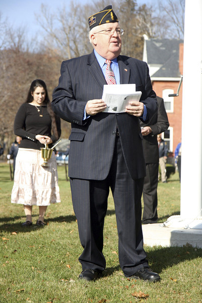 Kezia Chee/North Adams Transcript<br /> <br /> Post 160 Commander Ralph Schwarzer reads in memory of George Coope at the flagpole dedication at Pope John Paul the Great Parish in Adams Sunday morning. Coope was a longtime friend, sexton, and caretaker of both the St. Thomas Aquinas and Notre Dame churches.