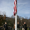 Kezia Chee/North Adams Transcript<br /> <br /> Shirley Denault, Jean Fortier, and Linda Lagess help raise the flag to honor their father, George Coope, at Pope John Paul the Great Parish in Adams on Sunday morning. Coope, who passed away in 2007, was both caretaker and sexton of the Notre Dame and St. Thomas Aquinas churches.