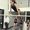 with JEn story<br /> Gillian Jones/North Adams Transcript<br /> Elizabeth Bona, 12, works on the low bar of the uneven bars.