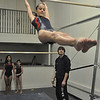 with Jen story<br /> Gillian Jones/North Adams Transcript<br /> Coach Jonathan Girard spots his student Elizabeth Bona, 12, as she works on the high bar.