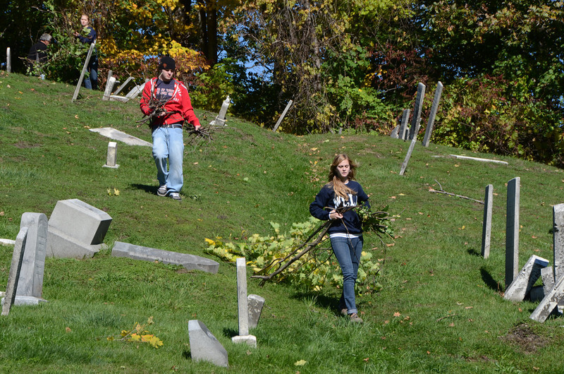 with Jen story<br /> Gillian Jones/North Adams Transcript<br /> MCLA sophomore Connor Brimmer and junior Katelyn Abbott carry some brush cut at the Hillside Cemetery in North Adams on Saturday morning as part of a day of service.