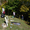 with Jen story<br /> Gillian Jones/North Adams Transcript<br /> MCLA students clear the brush around the Hillside Cemetery in North Adams on Saturday morning as part of a day of service.