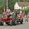 Gillian Jones/North Adams Transcript<br /> Don Leab of Ioka Valley Farm pulls a float with his tractor, down Main Street in the Hancock Memorial Day parade Sunday morning.