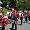 Ryan Hutton/North Adams Tanscript<br /> Members of the Hoosac Valley High School marching band march in the Cheshire Memorial Day parade.