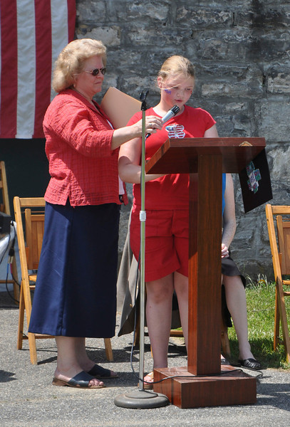 Ryan Hutton/North Adams Tanscript<br /> Cheshire Elementary School fourth grader Amber Brothers reads her essay on what Memorial Day means to her with Selectwoman Carol Francesconi holding the microphone.