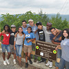 Ryan Hutton/North Adams Transcript<br /> The teens and counselors from the Manice Education Center in Florida stand by the new sign marking the trail they're working on.