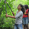 Ryan Hutton/North Adams Transcript<br /> Naiara Palma, 15, of the Bronx works to clear low hanging branches on the Mahican-Mohawk Trail in North Adams.
