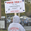 Gillian Jones/North Adams Transcript<br /> Voters hold signs outside of the Adams Town Garage on North Summer Street on Thursday during the special town election.