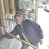 Gillian Jones/North Adams Transcript<br /> Pete Coussoule cleans the large glass windows on his storefront property at 35 Park Street in Adams on Friday afternoon. Coussoule is fixing up the empty store for a prospective tenant.