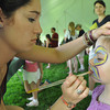 Gillian Jones/North Adams Transcript<br /> Zelie Lockhart, 17, paints a butterfly on the face of Madeline Alfieri, 5, at Riverfest at Cole Field in Williamstown on Saturday.