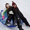 Gillian Jones/North Adams Transcript<br /> Faith Hall, 8, left, and Madeline Zelazo, 9, slide down 8th Hill at the Forest Park Golf Course in Adams on Wednesday as area students enjoyed their week off from school to play in the snow.