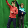 Kezia Chee/North Adams Transcript<br /> <br /> From left to right, brothers Josh and Jacob Crosby, 11 and 9, pose in front of a green screen to create a sports magazine cover at the Williamstown Youth Center's 9th annual Snowfest fundraiser, held in Williams College's Towne Field House.