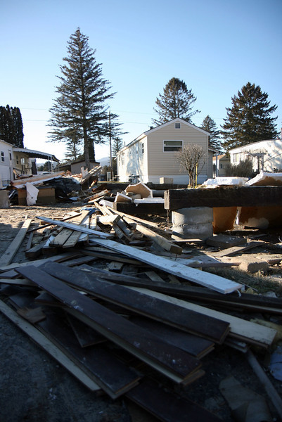 Kezia Chee/North Adams Transcript<br /> <br /> The demolished remains of a home in the Spruces appear even more severe next to others fully intact in Williamstown Monday afternoon.