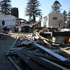 Kezia Chee/North Adams Transcript<br /> <br /> The demolished remains of a home in the Spruces appears even more severe next to others fully intact in Williamstown Monday afternoon.