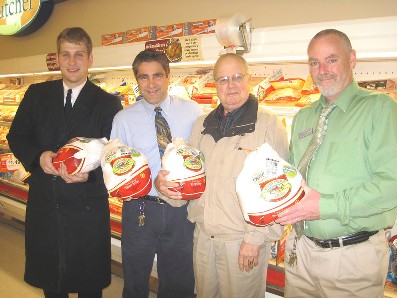 Glenn Drohan/North Adams Transcript<br /> Choosing holiday turkeys on Tuesday for the Salvation Army's food pantry are from left, Lt. Russell Crowsen of the North Adams Salvation Army, Ray Nichols, Stop & Shop customer service manager, Rodney Cowan, Transcript circulation manager, and Shawn McKeever, manager of the North Adams Stop & Shop.