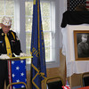 Meghan Foley/North Adams Transcript<br /> Kevin Hamel, commander of American Legion Post 152 in Williamstown, makes some closing remarks during the town's Veterans Day ceremony on Friday morning. To the right of Hamel is a portrait of Lt. Col. Charles W. Whittlesey of whom the legion hall was dedicated to during the ceremony.