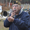 Gillian Jones/North Adams Transcript<br /> Paul Gigliotti plays taps at a brief ceremony for Veteran's Day at the Clarksburg Cemetery on Friday morning.