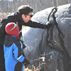 Sarah Howard/ Transcript Intern<br /> <br /> Nick Stroud and his son Knowl Stroud, age 4, look inside the  natural rock formation while on a hike, this Sunday, February 5, at Field Farm in Williamstown.