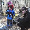 Sarah Howard/ Transcript Intern<br /> <br /> Knowl Stroud, age 4, and his father Nick Stroud kneel to get a closer perspective of the fallen nature, this Sunday February 5, at Field Farm in Williamstown.