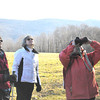 Sarah Howard/ Transcript Intern<br /> <br /> Barbara Hine (left) and Nacy Sommer ( second to left) look up into the trees with guide Leslie Reed-Evans (right) at an abandoned birds nest, this Sunday February 5, at Field Farm in Williamstown.