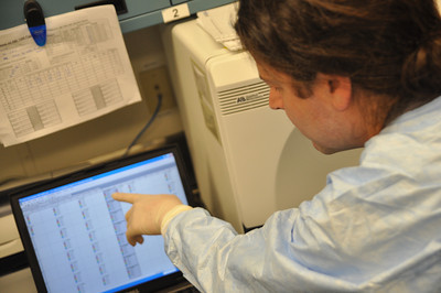 José Quezada/For the Times-Standard  Morgan Cook, Public Health Branch microbiologist II, points to a laptop screen that gives information provided from the ABI 7500 FAST Dx Thermocycler that gives onscreen chart and data detection of Vibrio parahaemolyticus DNA in local oysters.