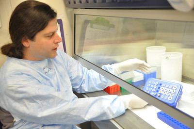 José Quezada/For the Times-Standard  Morgan Cook, Public Health Branch microbiologist II, holds a PCR plate of some prepared DNA extract that was added to the PCR reaction mixture.