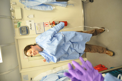 JosŽ Quezada/For the Times-Standard  Morgan Cook, Public Health Branch microbiologist II, dons sterile garb before entering the biohazard laboratory.