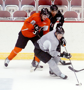 Adirondack Phantoms teammates on their first day of ice practice at the Glens Falls Civic Center, Friday will be their preseason exhibition game against the Albany Devils. Photo Erica Miller 9/29/10 spt_Phantoms2_Thurs