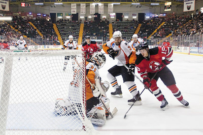 Albany Devils Player Patrick Davis goes in to score but is blocked by Phantoms defensman Marc-Andre Bourdon and Goalie Johan Backlund. Photo by Eric Jenks 10/16/10