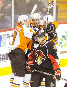 A dejected Binghamton Senator Geoff Kinrade skates past celebrating Adirondack Phantoms after Rob Bordson, center, scored past Binghamton goalie Robin Lehner in the first period of Wednesday's AHL matchup in Glens Falls. Ed Burke 1/26/11