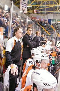 Phantoms Assistant Coach Riley Cote (Back Middle) watches the game with his team. Photo Eric Jenks 10/15/10