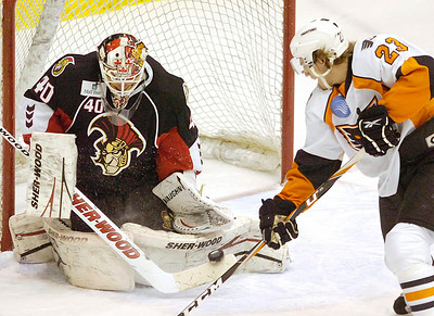 Adirondack's Ben Holmstrom looks for a rebound as Binghamton goalie Robin Lehner makes a save during Wednesday's game at the Glens Falls Civic Center. Ed Burke 1/26/11